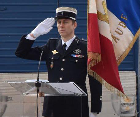 "This handout picture taken in Carcassone military headquarters in 2018 and released by the Gendarmerie Nationale on March 24, 2018 shows French Lieutenant Colonel Arnaud Beltrame who was killed after swapping himself for a hostage in a rampage and siege in the town of Trebes, southwestern France on March 23.  Beltrame, 45, was among a group of officers who rushed to the scene in Trebes, near Carcassone, on March 23 after a gunman who claimed allegiance to the Islamic State group, stormed a supermarket and fired at shoppers. Beltrame offered to take the place of a woman the gunman had taken hostage and was shot. He died on March 24 of his wounds, becoming the gunman's fourth victim. / AFP PHOTO / GENDARMERIE NATIONALE / HO / RESTRICTED TO EDITORIAL USE - MANDATORY CREDIT ""AFP PHOTO / GENDARMERIE NATIONALE"" - NO MARKETING NO ADVERTISING CAMPAIGNS - DISTRIBUTED AS A SERVICE TO CLIENTS"